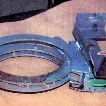The metal collar that held the bomb to Brian Wells was intact after the explosion; it operated like a large handcuff that was locked to his neck. The metal box that held the bomb mechanism was attached to the frame of the collar. RICH FORSGREN/ERIE TIMES NEWS, via FBI
