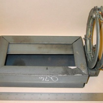 The FBI built this model of the collar and the box that contained the bomb; the box is empty of components. The collar is attached backwards here; Wells wore the bomb with the open section away from his chest, rather than against it. ERIE TIMES-NEWS/FBI