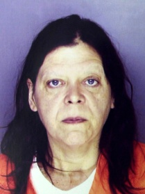 Marjorie Diehl-Armstrong, in the mug shot Erie police took of her after she was arrested in the shooting death of her live-in boyfriend Jim Roden, whose body was found in a freezer on September 21, 2003. Nearly four years later, a federal grand jury would indict her in the Brian Wells pizza bomber case and allege she killed Roden to keep him quiet about the bank-robbery plot in which Wells participated. ERIE TIMES-NEWS, via ERIE BUREAU OF POLICE