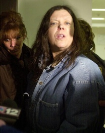"""Marjorie Diehl-Armstrong on January 20, 2004, after her preliminary hearing in the shooting death of her live-in boyfriend Jim Roden. The main witness against her was Bill Rothstein, her erstwhile fiancé, who had helped her stuff Roden's body in a freezer in Rothstein's garage. """"Rothstein is a filthy liar,"""" Diehl-Armstrong is telling reporters in this photo. """"Rothstein should be charged with the death of Brian Wells and a lot of other charges."""" Her statement attracted the FBI's attention in the pizza bomber case. JANET B. KUMMERER/ERIE TIMES-NEWS"""