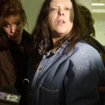 "Marjorie Diehl-Armstrong on January 20, 2004, after her preliminary hearing in the shooting death of her live-in boyfriend Jim Roden. The main witness against her was Bill Rothstein, her erstwhile fiancé, who had helped her stuff Roden's body in a freezer in Rothstein's garage. ""Rothstein is a filthy liar,"" Diehl-Armstrong is telling reporters in this photo. ""Rothstein should be charged with the death of Brian Wells and a lot of other charges."" Her statement attracted the FBI's attention in the pizza bomber case. JANET B. KUMMERER/ERIE TIMES-NEWS"