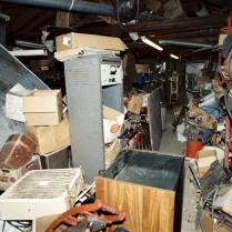Bill Rothstein's house was just as filthy and messy as Diehl-Armstrong's. In his garage, where he had been storing Jim Roden's body in a freezer, Rothstein also kept the bloody mattress (at left) on which Roden had died at Diehl-Armstrong's house. FBI photo, entered into evidence at trial