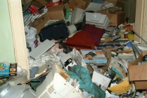 Ken Barnes' house was in worse condition than those of Marjorie Diehl-Armstrong and Bill Rothstein. Barnes ran a crack house amid the trash; prostitutes turned tricks for drugs in a squalid bedroom upstairs, where Brian Wells spent time with prostitute Jessica Hoopsick. FBI photo, entered into evidence at trial