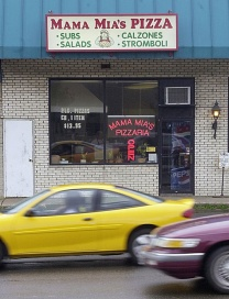 At 1:30 p.m. on August 28, 2003, an order phoned in to this pizza parlor sent Brian Wells on his way in the bank-robbery plot that would end in his bombing death at 3:18 p.m. Wells, 46 years old, had worked at Mama Mia's nearly a decade. ISAAC BREKKEN/ERIE TIMES-NEWS
