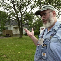 Bill Rothstein talks to a reporter from the Erie Times-News in front of Rothstein's house on August 30, 2003, two days after the bombing death of Brian Wells. The house is at the start of the dirt road that Wells drove down to make his final pizza delivery on August 28, 2003; Rothstein said he noticed nothing unusual that day. During the time of this interview, Jim Roden's body was stuffed inside a freezer in Rothstein's garage, in the background. It would be discovered a month later. RICH FORSGREN/ERIE TIMES-NEWS