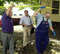Bill Rothstein, having turned state's evidence, helps the Erie police at Marjorie Diehl-Armstrong's house on September 23, 2003. Rothstein would die of cancer in 2004, before he could be indicted in the pizza bomber case. RICH FORSGREN/ERIE TIMES-NEWS