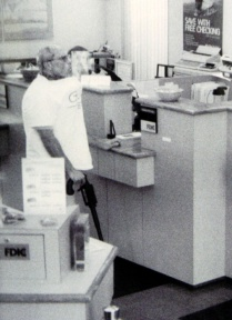 Brian Wells stands at the front counter of the PNC Bank in the Summit Towne Centre, waiting for the chief teller to give him money on August 28, 2003. He had asked for $250,000, an extraordinary amount for a bank robbery. RICH FORSGREN/ERIE TIMES-NEWS, via FBI
