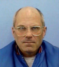 Brian Wells, in one of the few photographs of him that was made public after his bombing death on August 28, 2003. This is from his driver's license. RICH FORSGREN/ERIE TIMES-NEWS